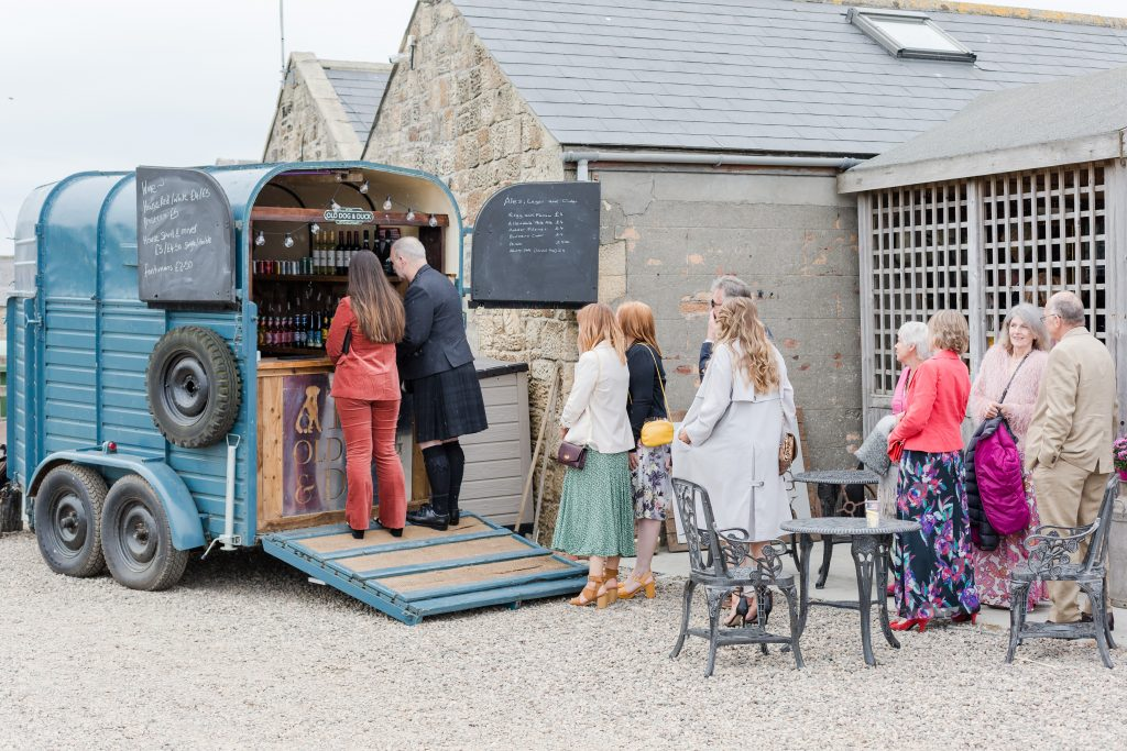 guests waiting at festival horse box bar