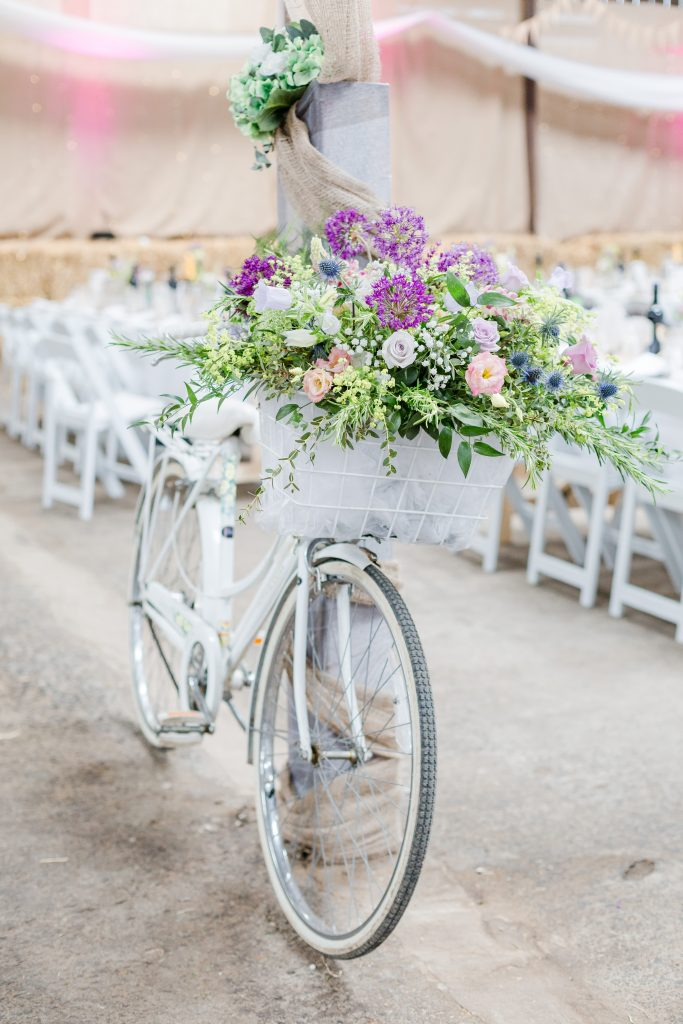 white vintage bike with flower display in basket