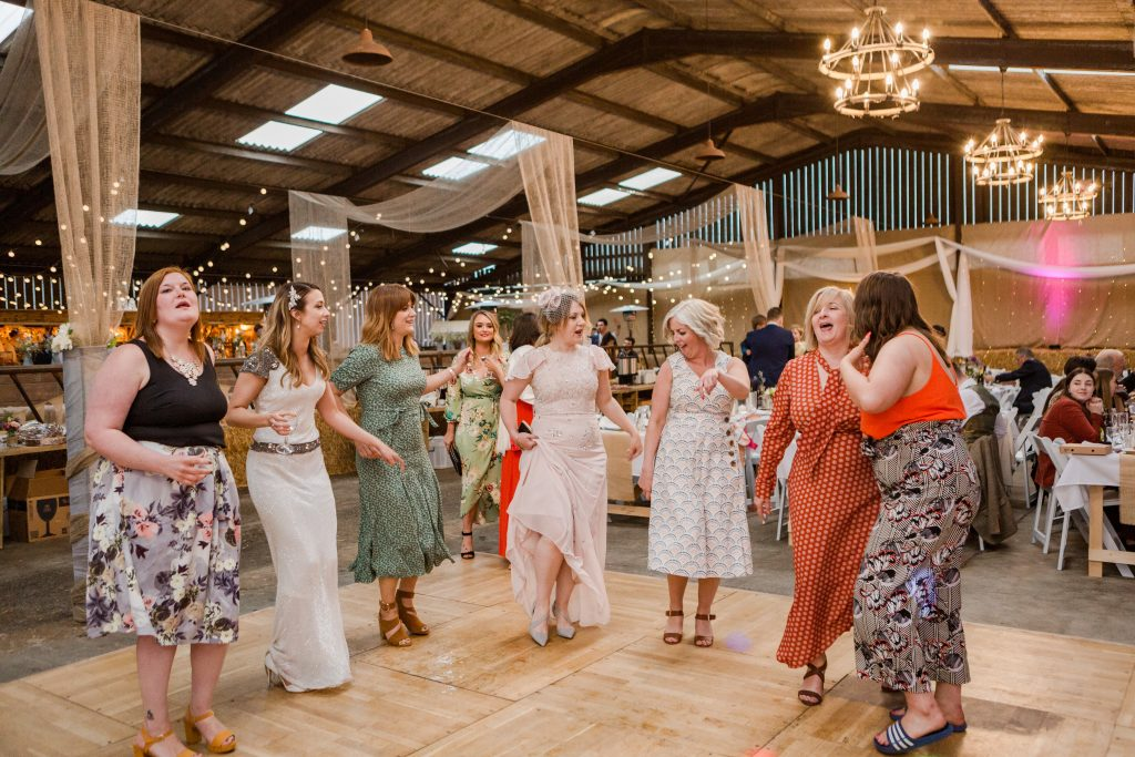 bride and wedding guests dancing on festival wedding dance floor