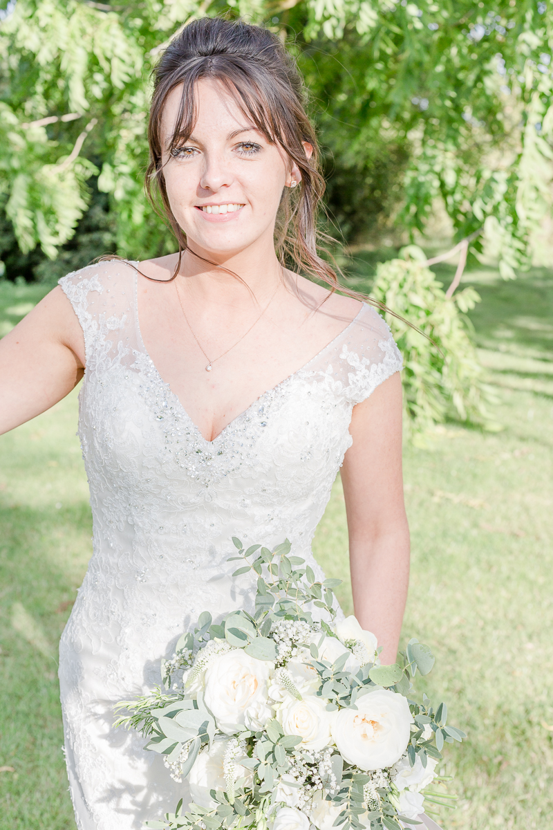 bride outside smiling into camera