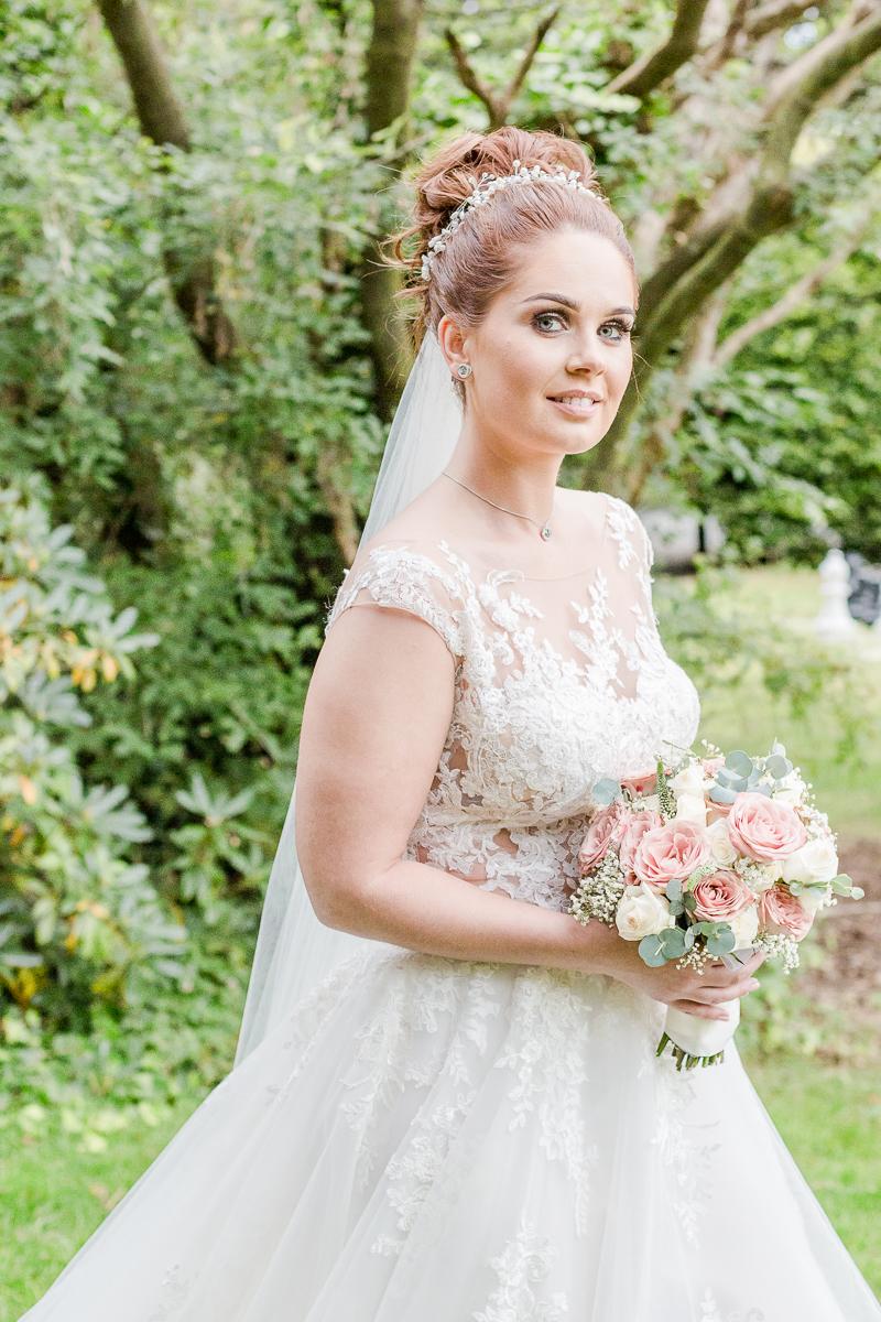 bride smiling at camera side on