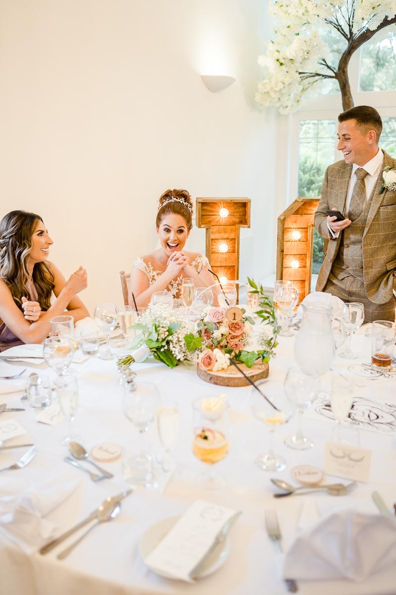 groom giving speech bride pulling face