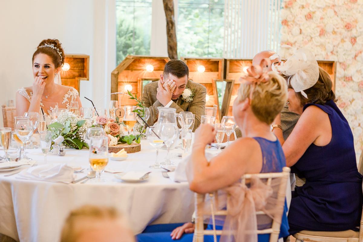 groom hiding behind hands during speech