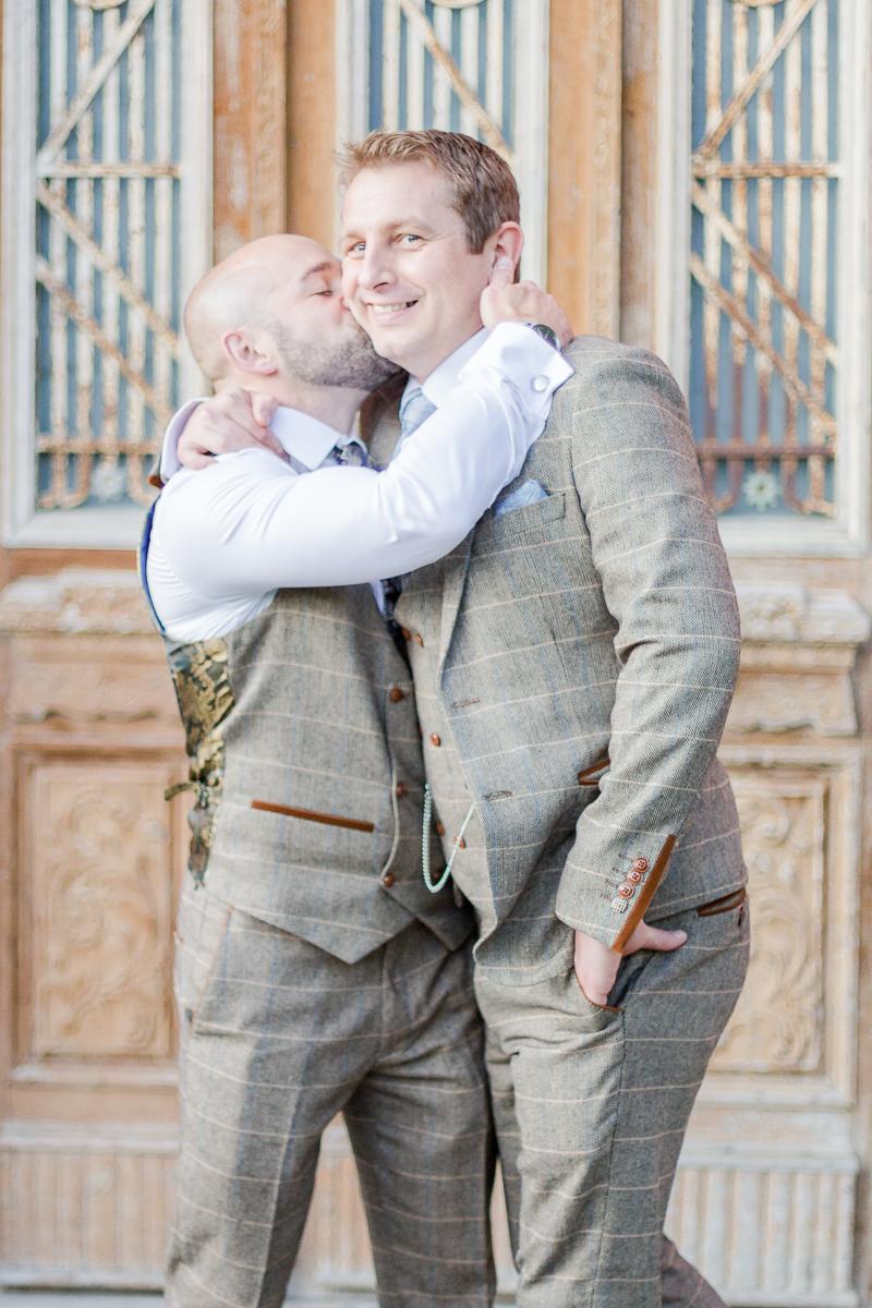 groomsman playfully kissing groom