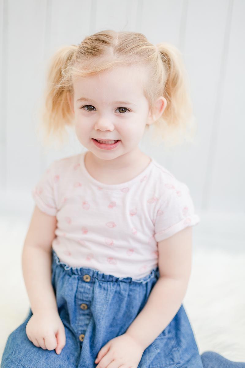 toddler in photo studio smiling into camera
