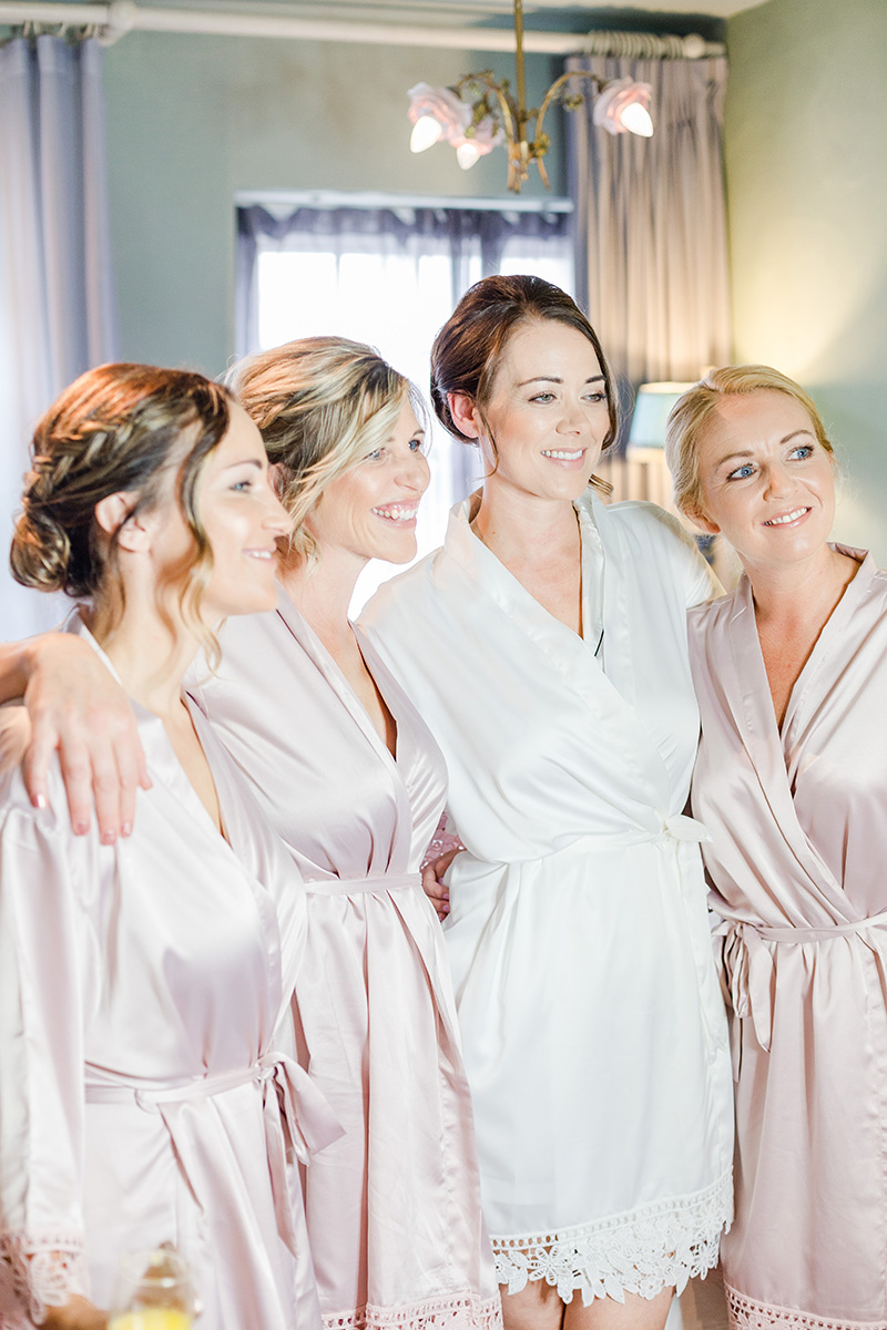 bride with three bridesmaids all in dressing gowns
