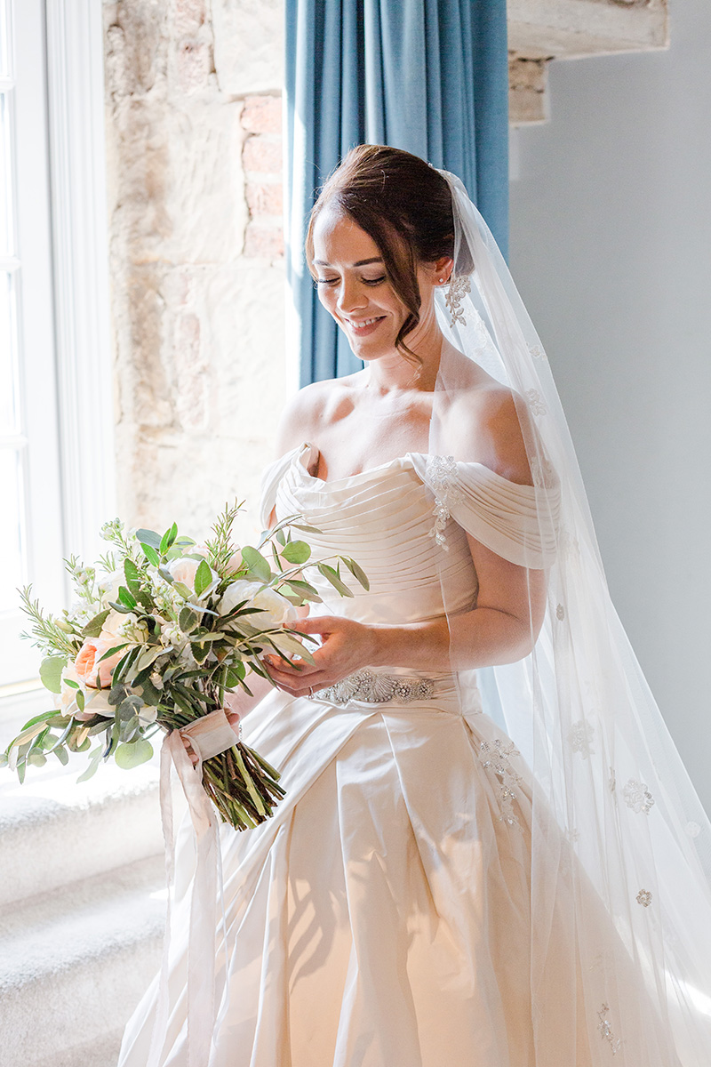 bride just ready and looking at her bouquet