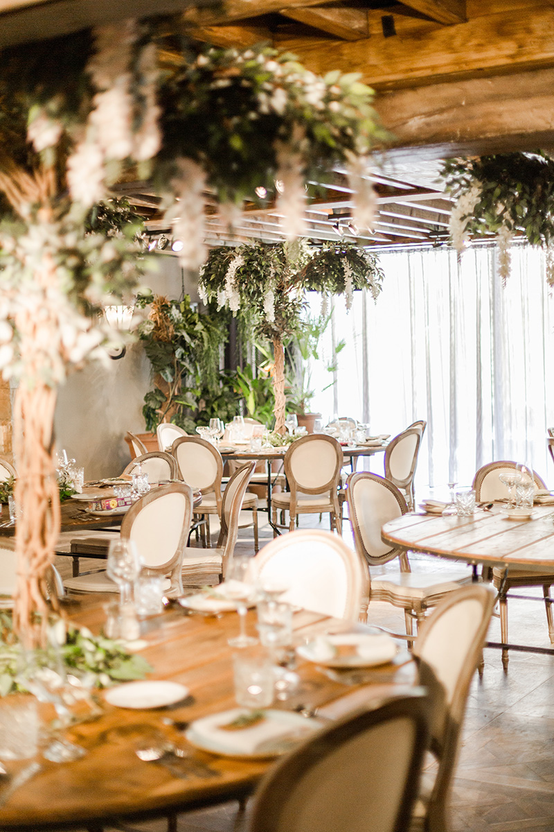 tables set with meditteranean trees as centre pieces