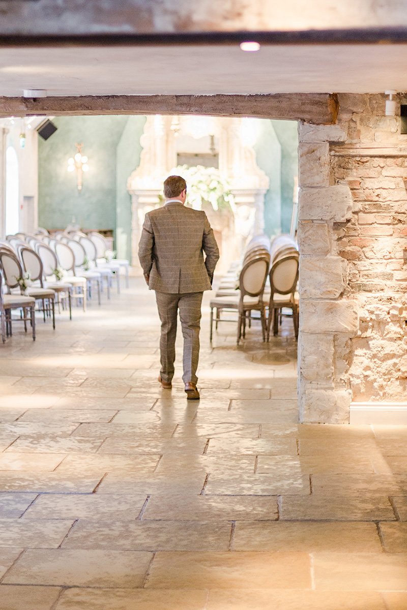 groom walking into ceremony room