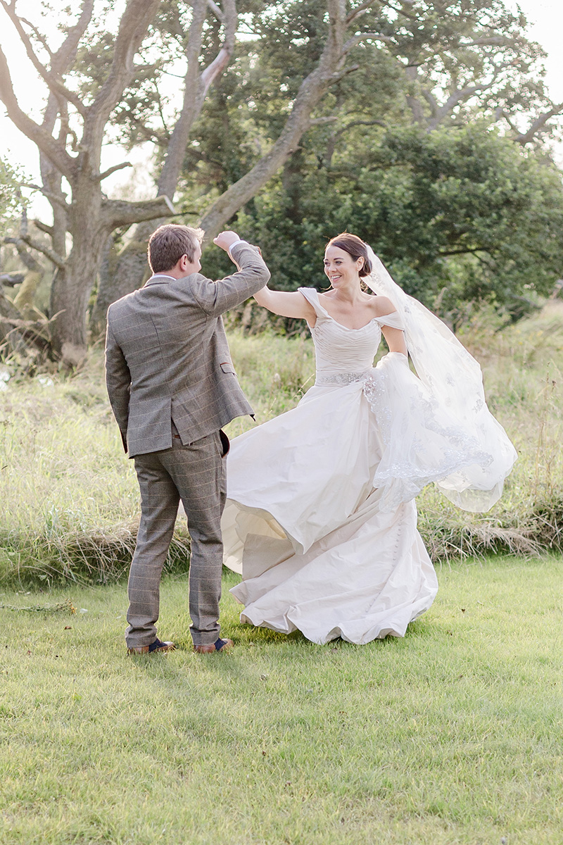 bride and groom dancing in gardens