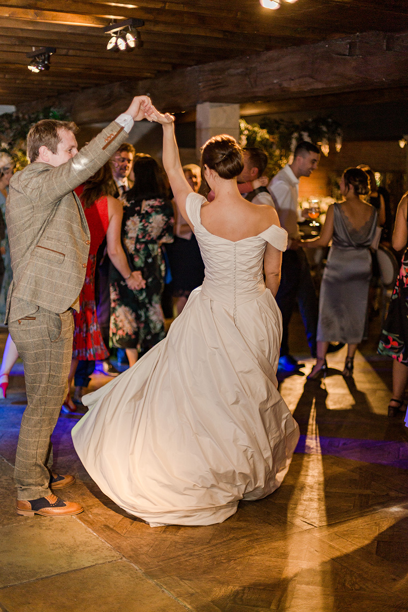 groom swirling bride in first dance