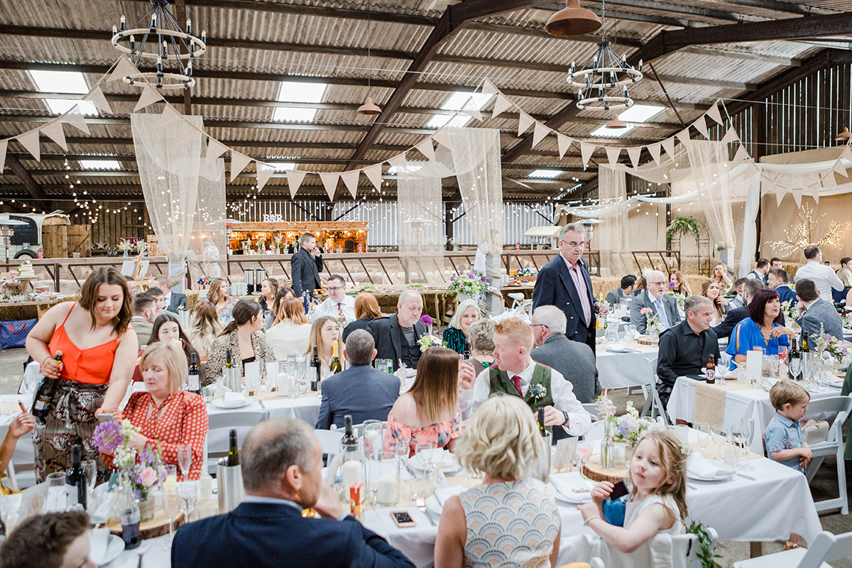 Festival wedding meal with bunting and long tables
