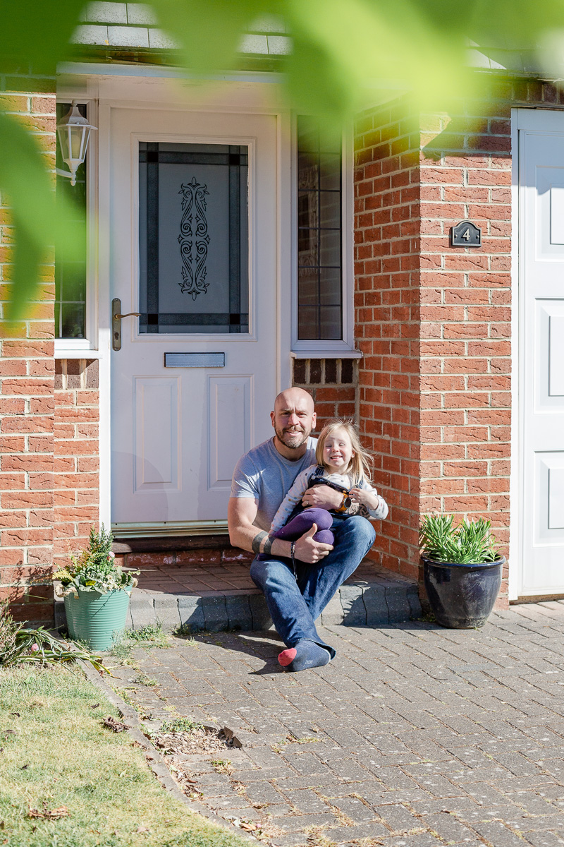 daddy and daughter sat on doorstep