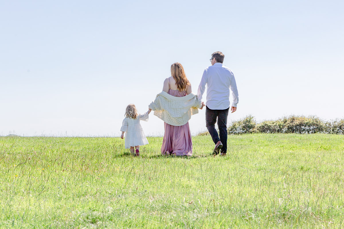 family walking away through field