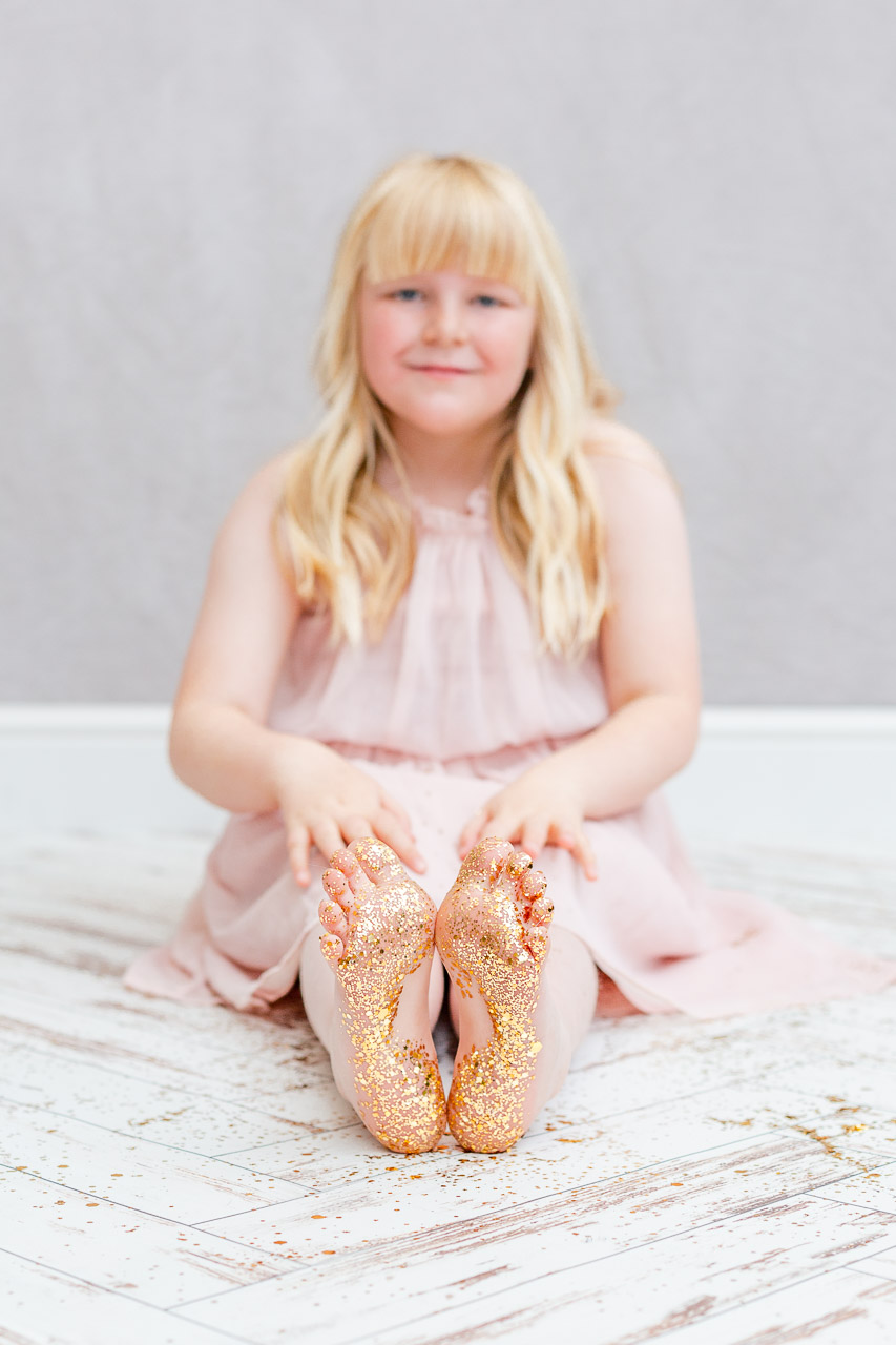 little girl glitter shoot feet covered in glitter