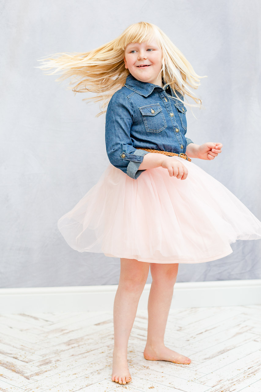 little girl spinning in tulle dress