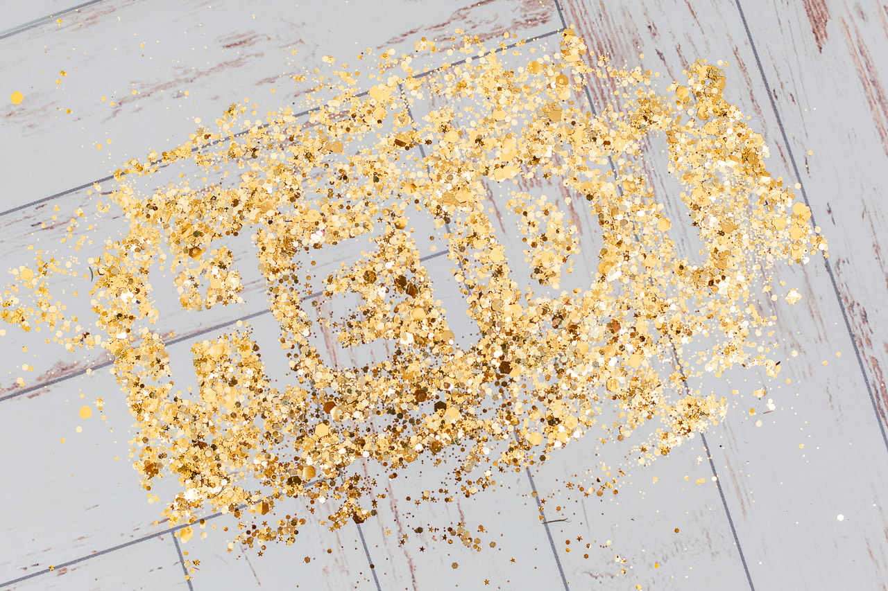 glitter on floor spelling Heidi