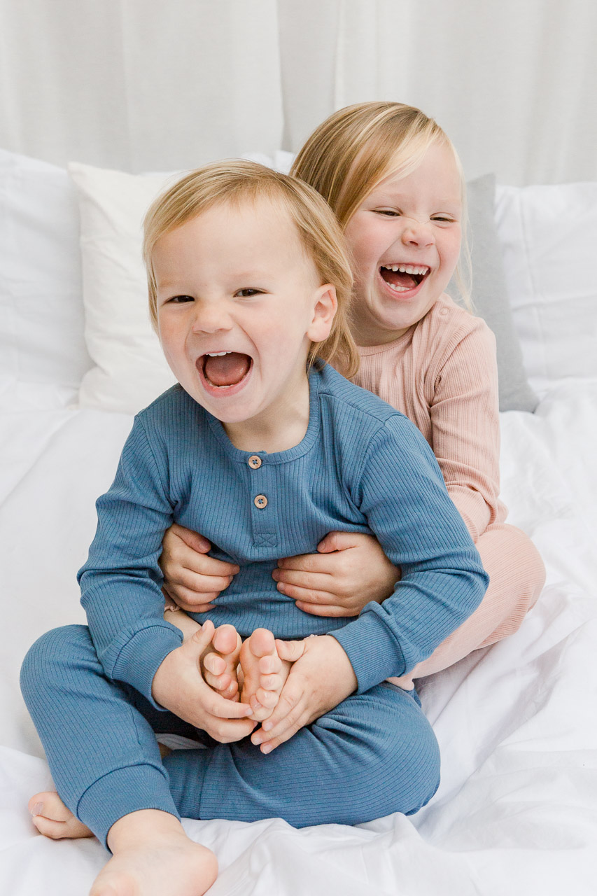 little boy and girl laughing at camera
