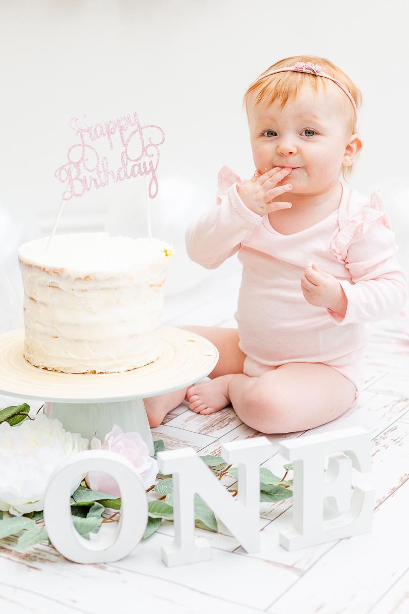 one yearly cake smash baby happy eating cake