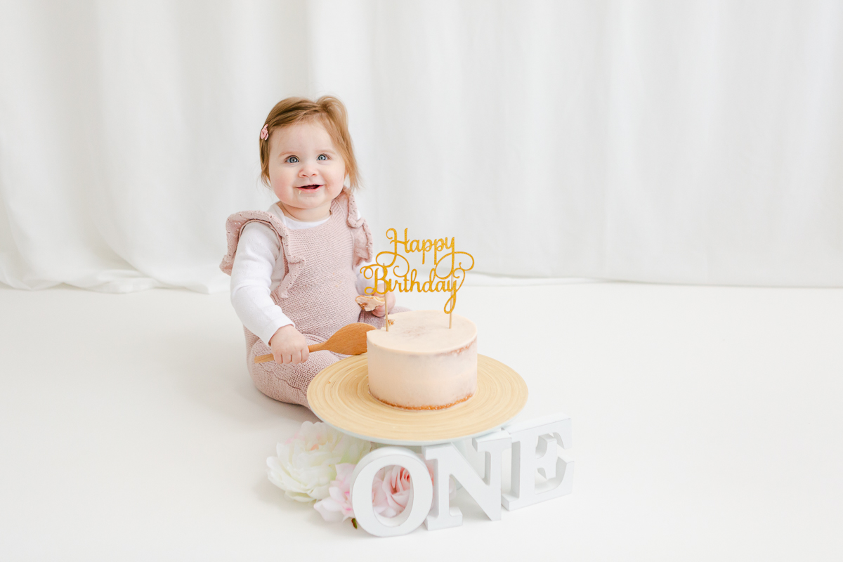 first birthday cake smash for little girl in pink